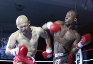 C. Warren Peace: Kickboxing-A right hook landing